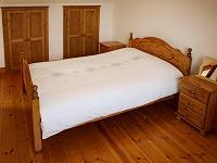 Ein Schlafzimmer im Ferienhaus